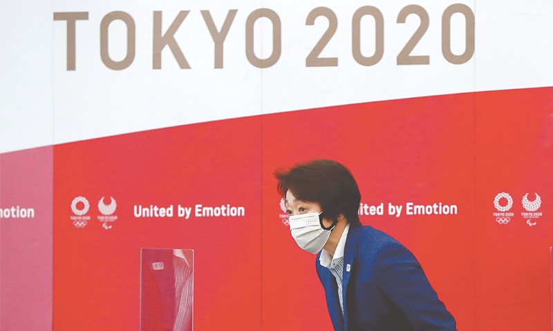 TOKYO 2020 Olympics Organising Committee president Seiko Hashimoto bows upon her arrival at the fourth roundtable meeting with medical experts to discuss on coronavirus disease countermeasures on Friday.—Reuters