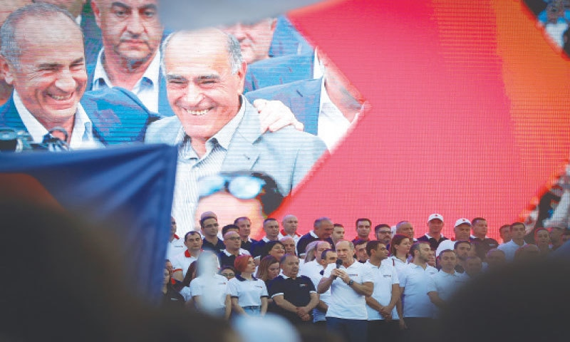 FORMER Armenian president Robert Kocharyan (with microphone) greets his supporters during the rally.—AP