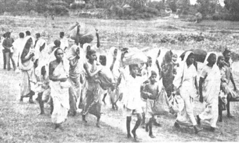 A group of Pakistani citizens who had crossed over to India during the disturbances in East Pakistan are seen approaching the Reception Centre at Meherpur in Kushtia district.