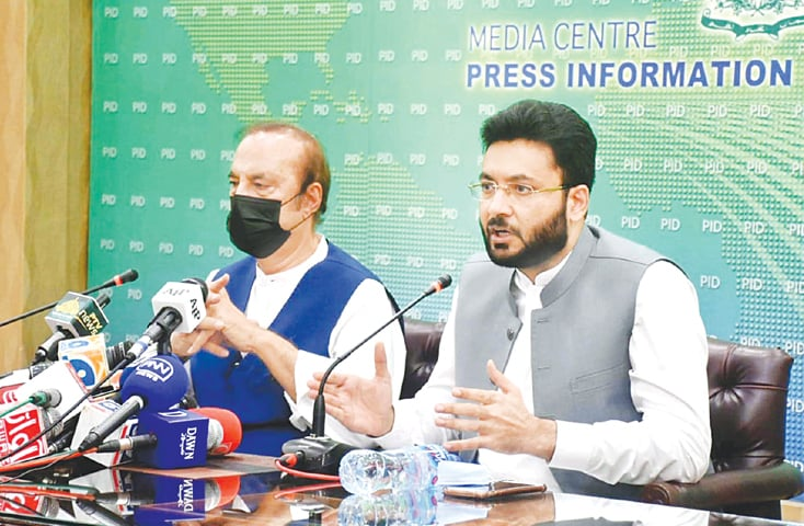 ISLAMABAD: Minister of State for Information and Broadcasting Farrukh Habib, along with Babar Awan, Adviser to the PM on Parliamentary Affairs, addressing a press conference on Friday.—PPI