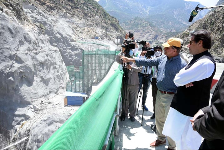 DASU: Prime Minister Imran Khan being briefed on the construction work at Dasu hydropower project on Friday.— PPI