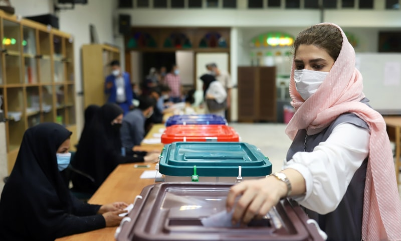 An Iranian woman casts her vote during the presidential election at a polling station in Tehran, Iran. — Reuters