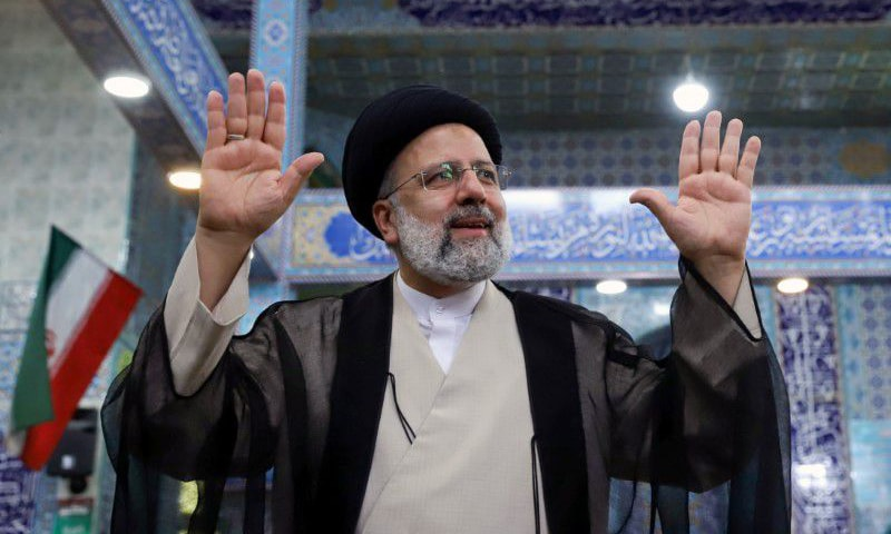 Ebrahim Raisi gestures after casting his vote during presidential elections at a polling station in Tehran. — Reuters
