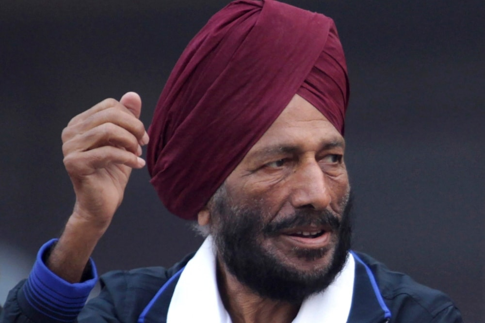 In this 2013 file photo, former Indian athlete Milkha Singh waves to the participants during the Delhi Half Marathon in New Delhi. — AP
