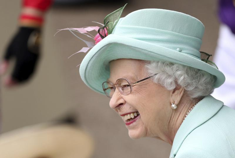 Queen Elizabeth II smiles, during day five of of the Royal Ascot horserace meeting, at Ascot Racecourse, in Ascot, England, June 19. — AP