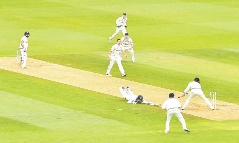 SOUTHAMPTON: Indian opener Shubman Gill dives to make the crease during the ICC World Test Championship final against New Zealand at the Ageas Bowl on Saturday. — AFP