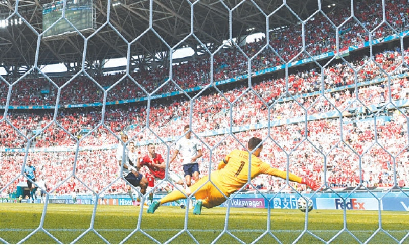 BUDAPEST: Attila Fiola of Hungary (third R) scores during the Euro 2020 Group 'F' match against France at the Puskas Stadium on Saturday. — AP