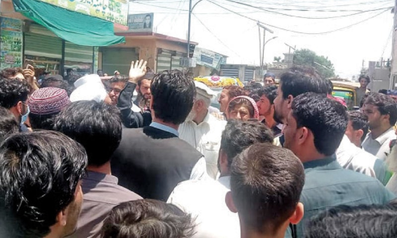 People stage a  demonstration against shortage of coronavirus vaccine in Bajaur tribal district. — Dawn