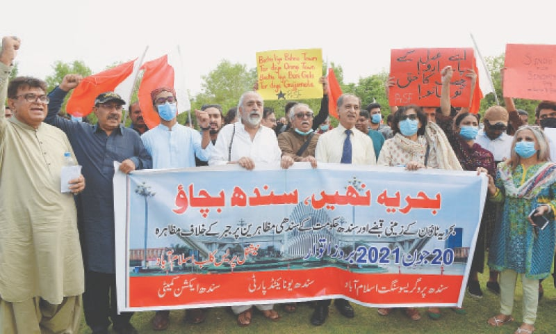 ISLAMABAD: Activists and supporters of the Sindh Progressive Sangat, Islamabad, raise slogans against Bahria Town Karachi during a demonstration in front of the National Press Club on Sunday.—Mohammad Asim / White Star