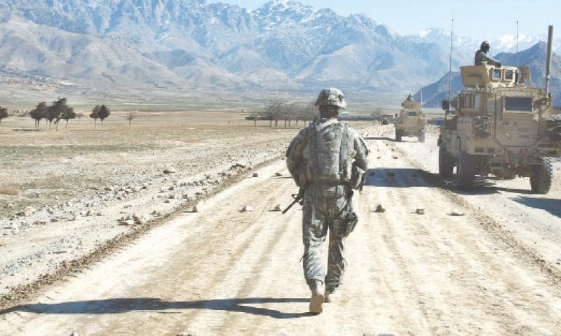 A Jan 11, 2010, file photo shows a US soldier walking along a road under construction near Bagram.—AFP