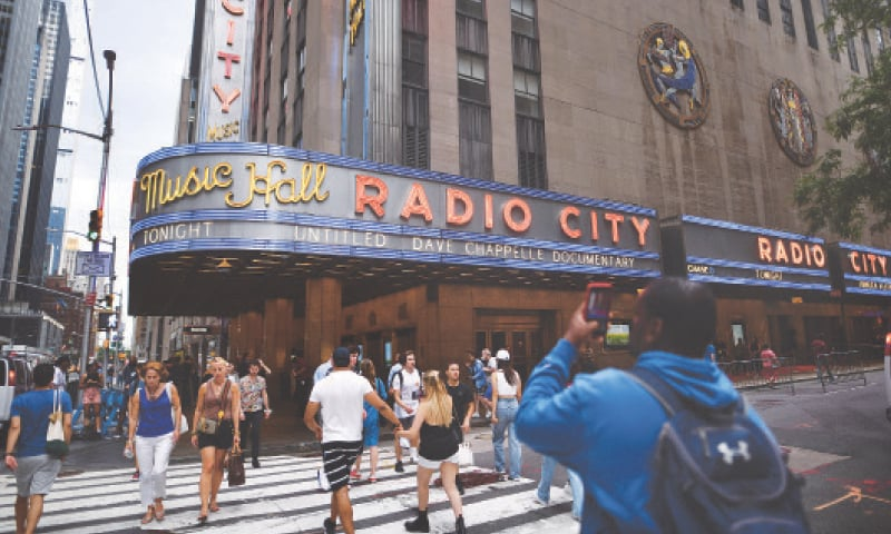 NEW YORK: Radio City Music Hall's marquee advertises Dave Chappelle's untitled documentary on the closing night of the Tribeca Festival on Saturday.—AP