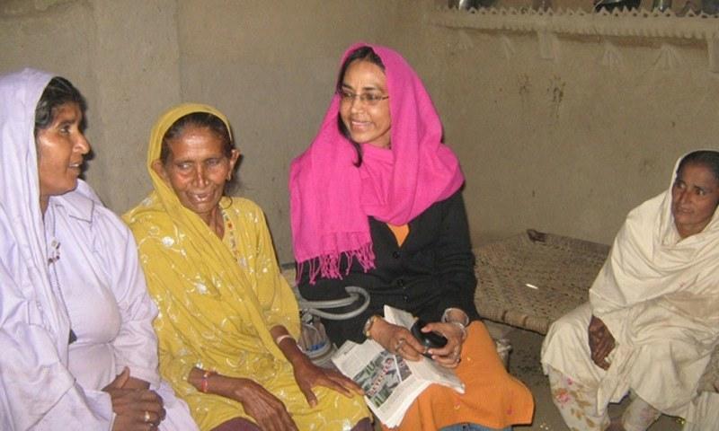 This file photo shows Perween Rahman with the women in Orangi. — Photo courtesy OPP
