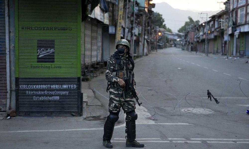 An Indian Paramilitary soldier patrols during curfew in Srinagar. — AP/File