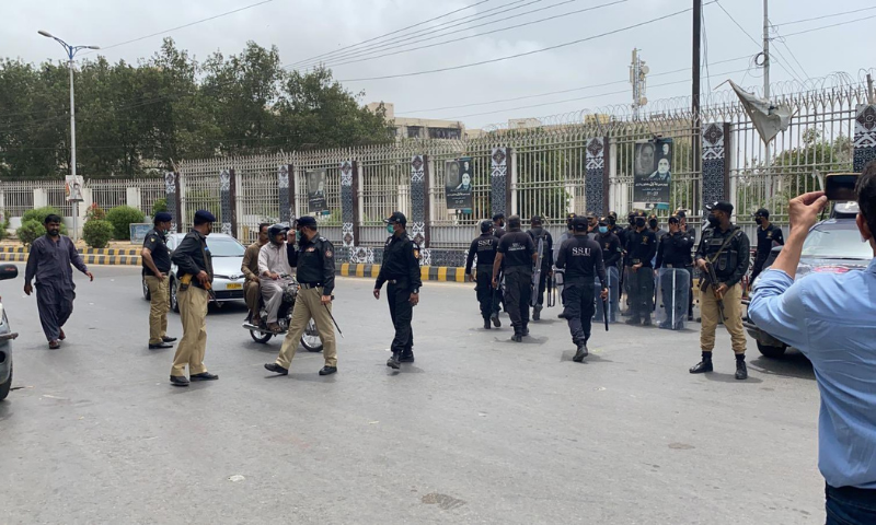 Policemen are seen near the Bilawal House in Karachi as people gather to protest demolitions along the Gujjar nullah. — Photo courtesy Karachi Bachao Tehreek Twitter
