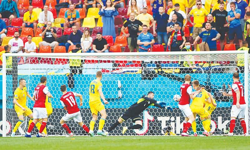 BUCHAREST: Austria's Christoph Baumgartner (third L) scores during the Euro 2020 Group 'C' match against Ukraine at National Arena Bucharest on Monday.—Reuters