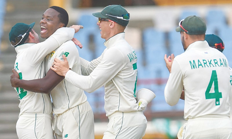 GROS ISLET: South African pacer Kagiso Rabada (second L) celebrates with team-mates after dismissing Shai Hope of West Indies during the second Test at Darren Sammy Cricket Ground on Monday.—AFP