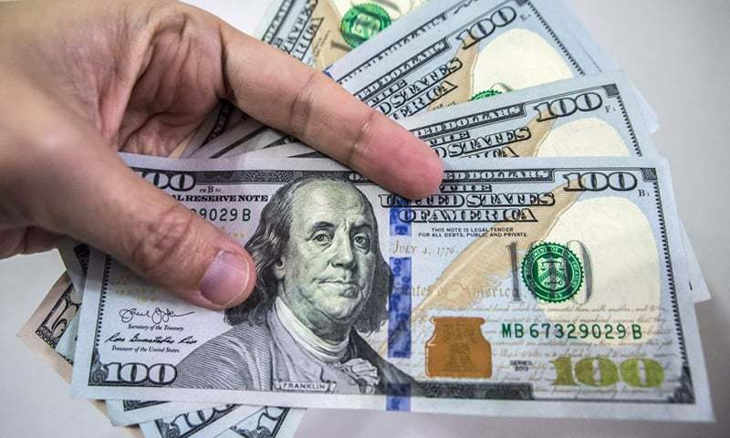 The US dollar continued to move upwards on Monday with a 62-paisa gain in the interbank market to hit Rs157.51 against the rupee. — AFP/File