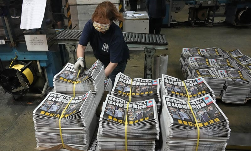 In this Friday, June 18, 2021, file photo, a worker packs copies of the Apple Daily newspaper at the printing house in Hong Kong. — AP