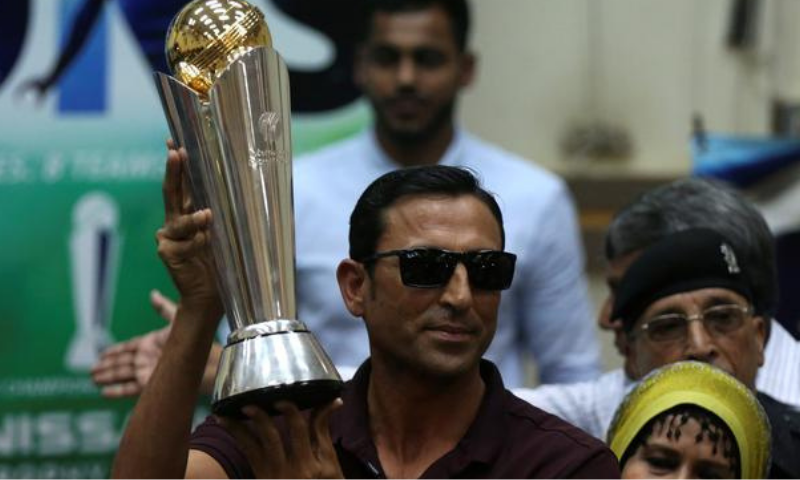 Former cricket captain Younis Khan displays the 2017 ICC Champions Trophy during a ceremony at the University of Karachi. — Reuters/File