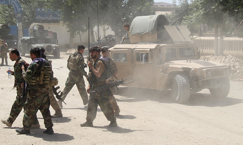 Afghan Commando forces are seen at the site of a battle field where they clash with the Taliban insurgents in Kunduz province, Afghanistan on Tuesday. — Reuters