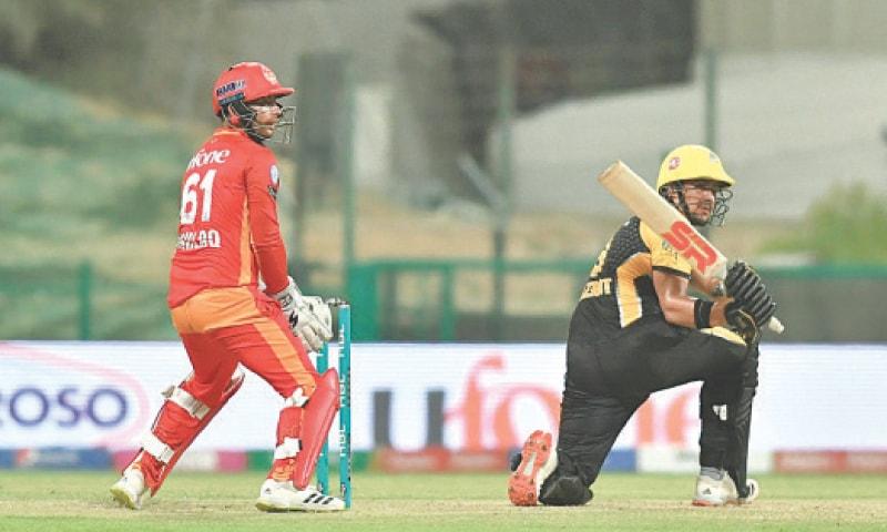 ABU DHABI: Peshawar Zalmi opener Hazratullah Zazai sweeps powerfully on his way to 66 runs against Islamabad United.—Courtesy PCB