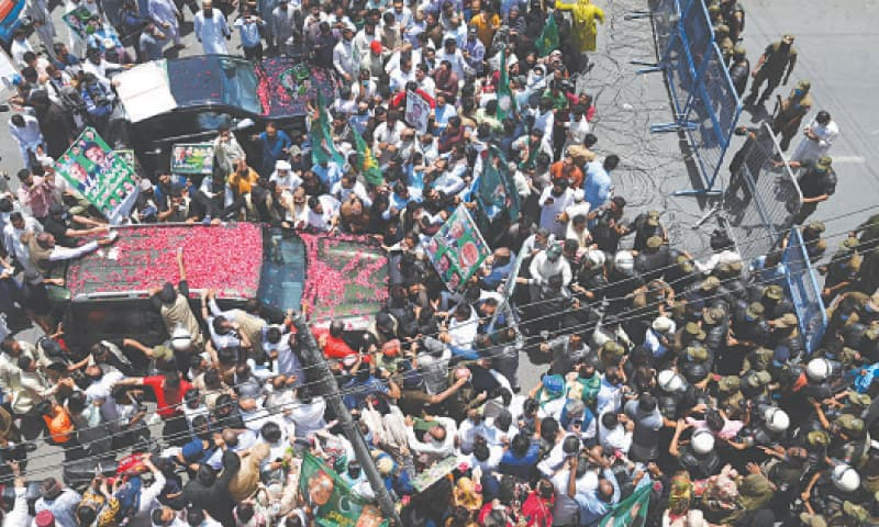 ON the occasion of Shehbaz Sharif's appearance before FIA officials, PML-N workers clash with police on Temple Road, Lahore.—M. Arif / White Star