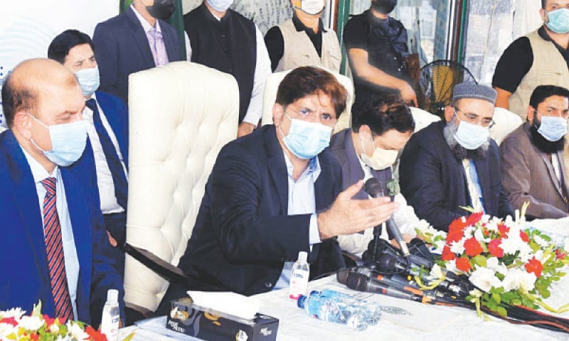 The chief minister speaks to the media at Nadra's DHA centre on Tuesday.—PPI