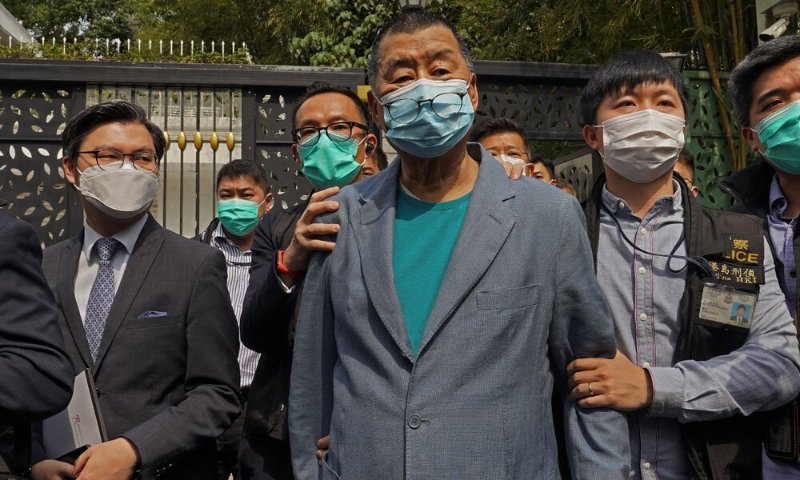 Hong Kong media tycoon Jimmy Lai, center, who founded local newspaper Apple Daily, is arrested by police officers at his home in Hong Kong on April 18, 2020. — AP/File