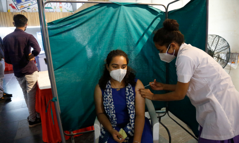 A woman receives a dose of the Oxford-AstraZeneca vaccine for Covid-19 in Ahmedabad, India. — AP
