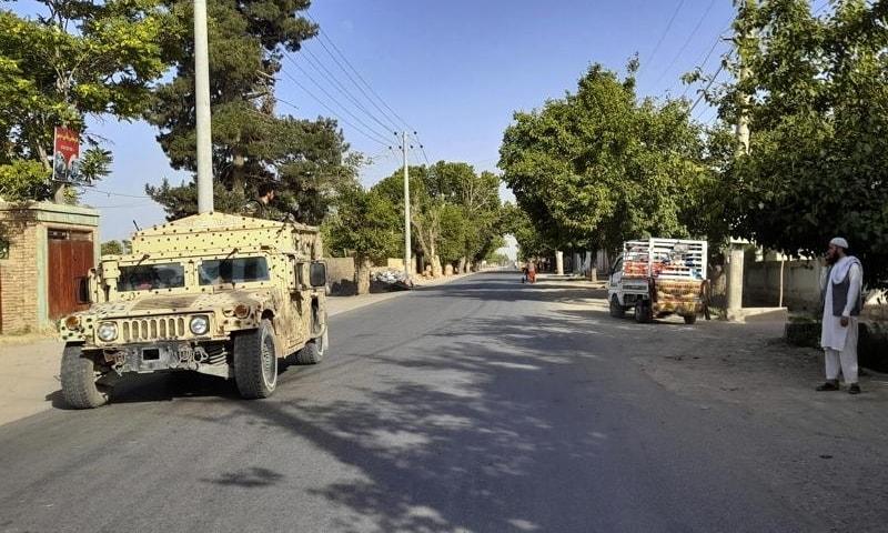 An Afghan army Humvee patrols in Kunduz city, north of Kabul, Afghanistan, June 21. — AP