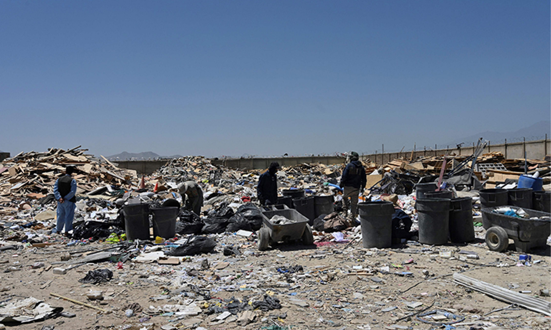 People look for useable items at a junkyard near the Bagram Airbase in Bagram. — AFP