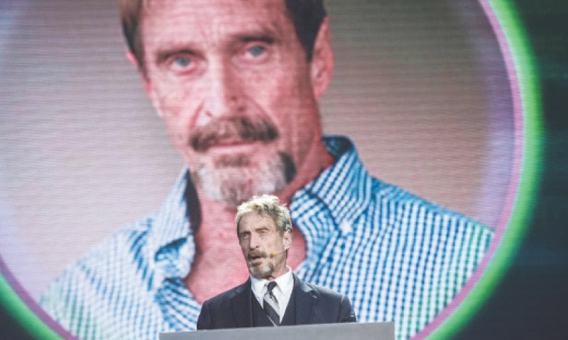 A file photo taken on Aug 16, 2016, shows John McAfee speaking during an internet security conference in Beijing.—AFP
