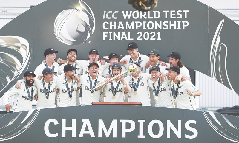 SOUTHAMPTON: New Zealand players celebrate with the trophy after winning the World Test Championship final against India at the Rose Bowl on Wednesday.—AP