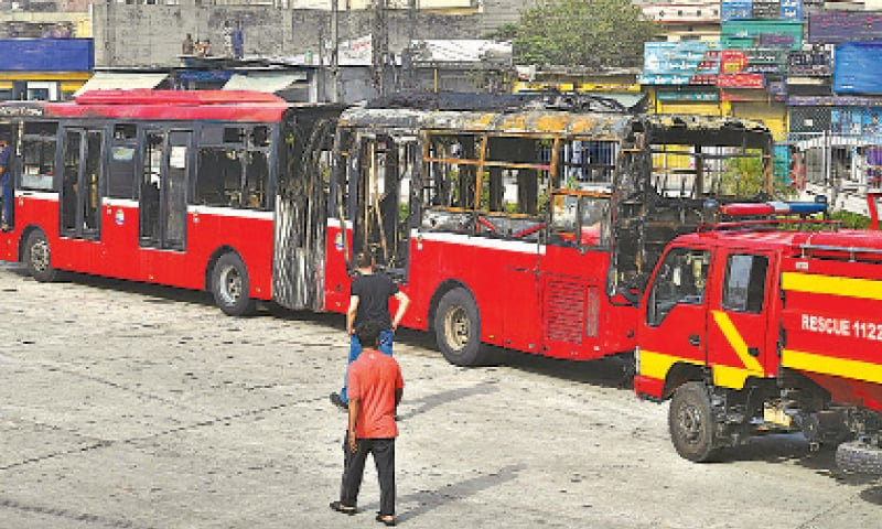 The Metro bus damaged by a fire due to a short circuit near Minar-i-Pakistan. — White Star