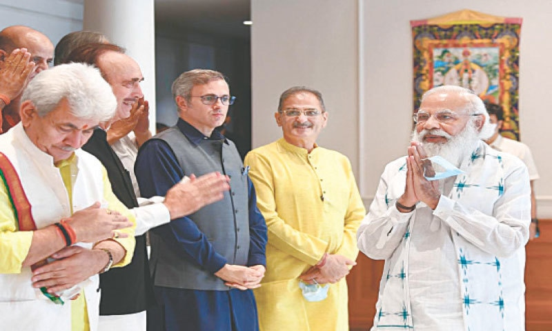 This photograph provided by the PM office shows Indian Prime Minister Narendra Modi greeting members of various political parties before the start of their meeting in New Delhi on Thursday.—AP