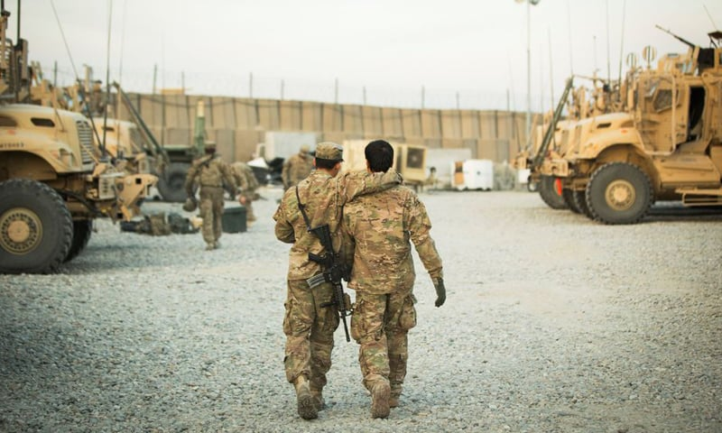 A US soldier from the 3rd Cavalry Regiment walks with the unit's Afghan interpreter before a mission near forward operating base Gamberi in the Laghman province of Afghanistan in December 11, 2014. — Reuters/File