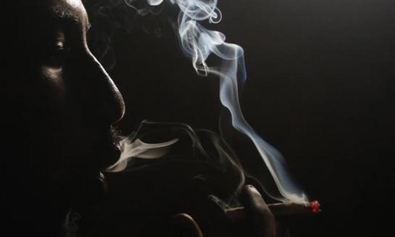 A heroin addict smokes heroin in Lamu, Kenya. — Reuters/File