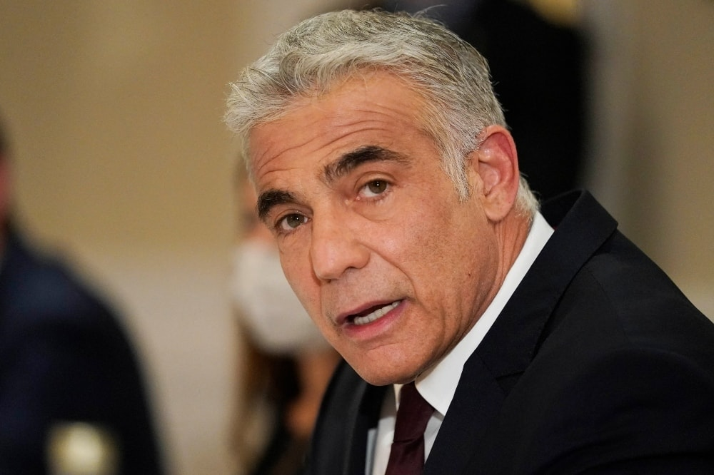 Israeli Foreign Minister Yair Lapid meets with Secretary of State in Rome, on June 27. — AFP