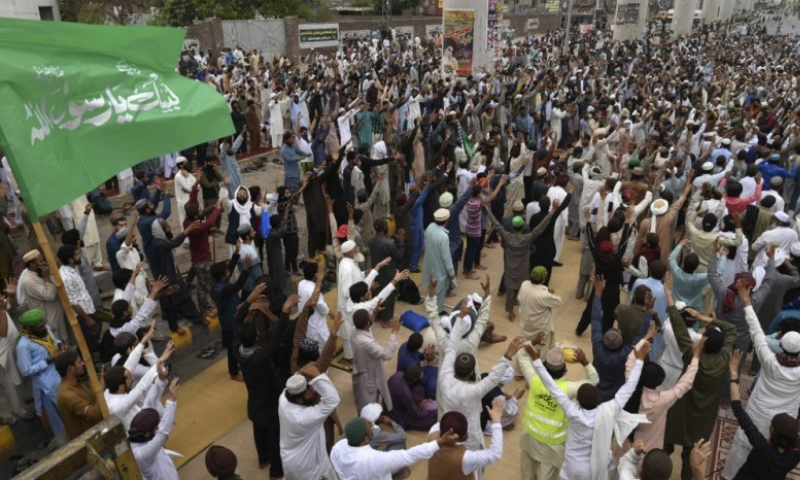 In this April file photo, supporters of the Tehreek-i-Labbaik Pakistan (TLP) chant slogans as they block a street during a protest in Lahore. — AFP