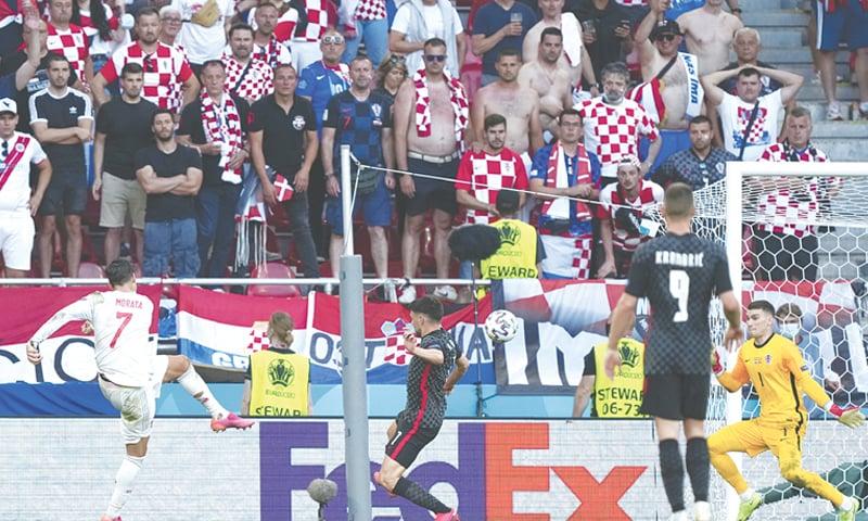 COPENHAGEN: Spain's Alvaro Morata (L) shoots to score during the Euro 2020 round-of-16 match against Croatia at the Parken Stadium on Monday.—AP