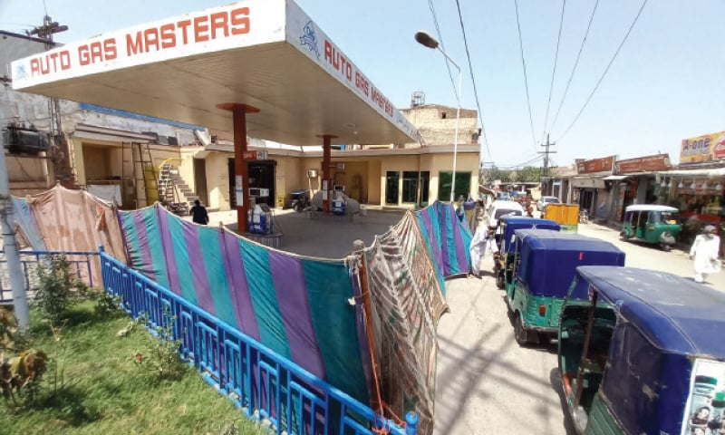 Rickshaws parked outside a closed CNG station on Kohat Road, Peshawar, on Tuesday. — White Star