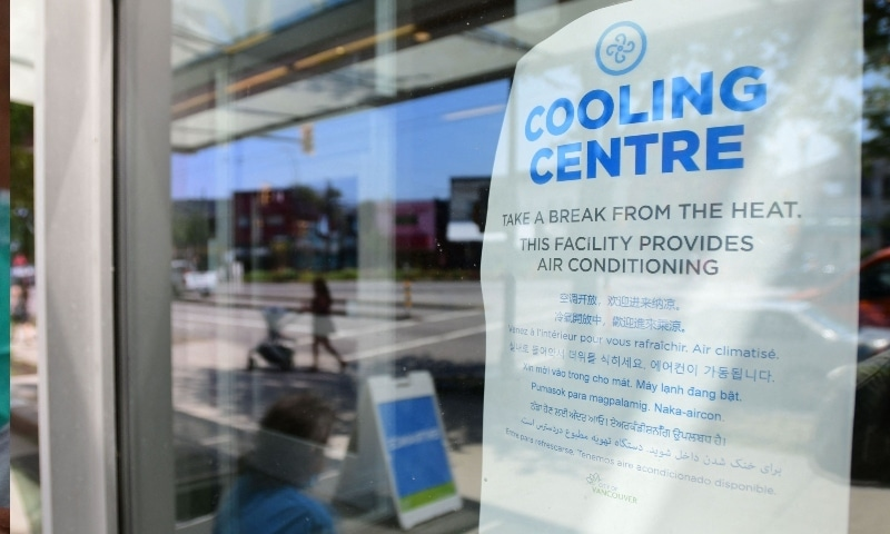 A welcoming sign is seen on the door of the Hillcrest Community Centre where they can cool off during the extreme hot weather in Vancouver, Canada on June 30. — AFP