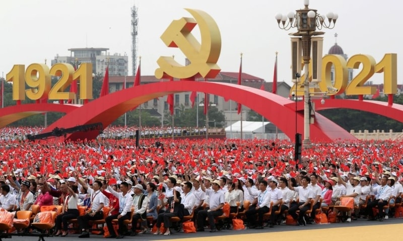 Participants wave national and party flags before the event marking the 100th founding anniversary of the Communist Party of China, on Tiananmen Square in Beijing, China, July 1. — Reuters