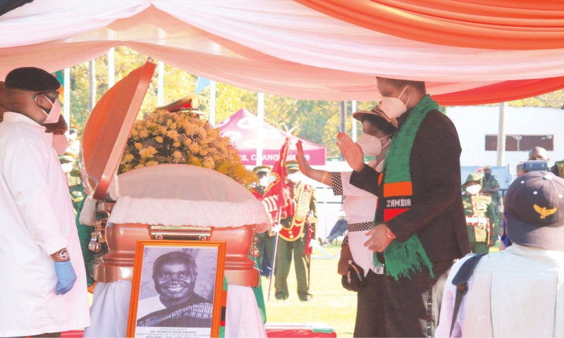 Zambian President Edgar Lungu and First Lady Esther Lungu pay their last respects to Kenneth Kaunda during his state memorial service on Friday. —AFP