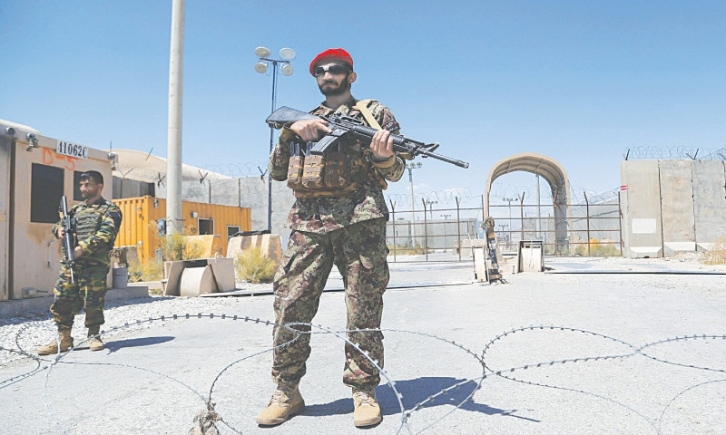 KABUL: Personnel of the Afghan National Army stand guard at the Bagram air base after all the US and Nato troops left it on Friday.—AFP