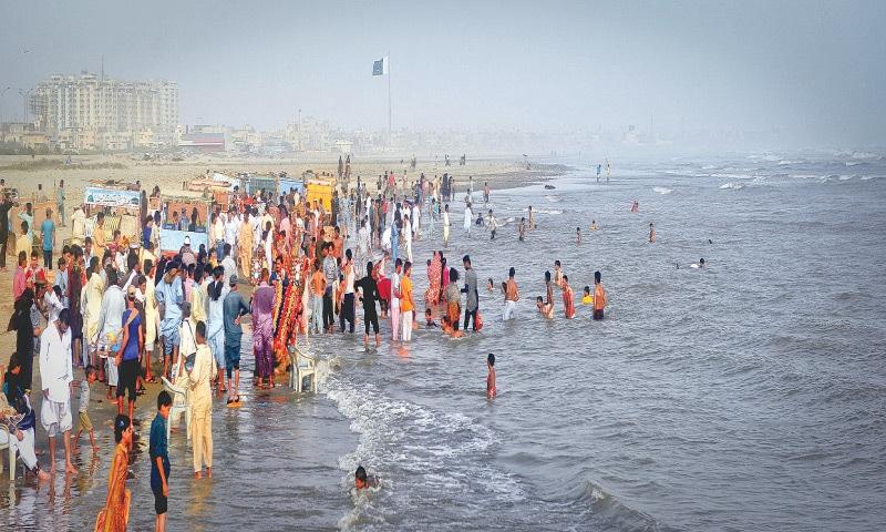Karachiites swim and splash around at Clifton Beach during a pre-Covid-19 summer | Fahim Siddiqi/White Star