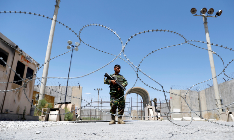 An Afghan National Army soldier stands guard at the gate of Bagram US air base, on the day the last of American troops vacated it, Parwan province, Afghanistan. — Reuters