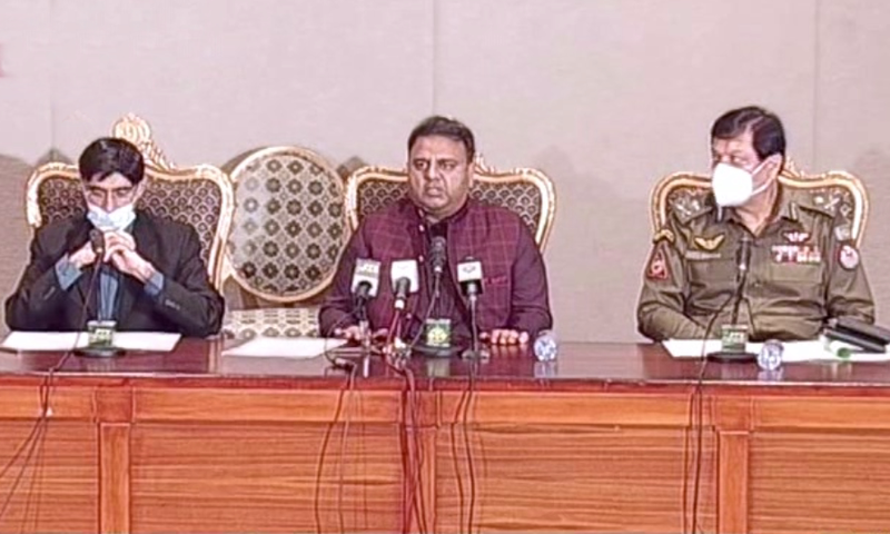 NSA Dr Moeed Yusuf addresses a press conference alongside the Punjab police chief and Information Minister Fawad Chaudhry. — DawnNewsTV