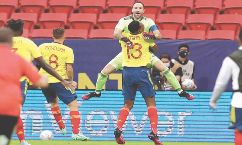 BRASILIA: Colombian goalkeeper David Ospina celebrates with team-mate Yerry Mina their penalty shootout win in the Copa America quarter-final against at the National Stadium.—AP