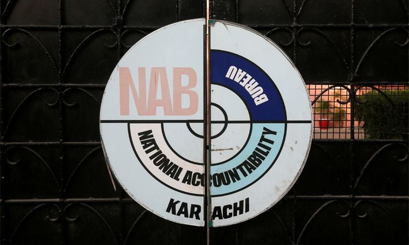 A logo of the National Accountability Bureau (NAB) is seen on the main entrance of their office in Karachi, Pakistan. — Reuters/File